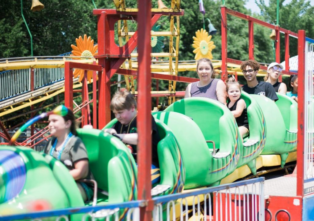 riding a kiddie roller coaster at the texas crawfish and music festival in old town spring 2018 houston lifestyle blogger mom blog