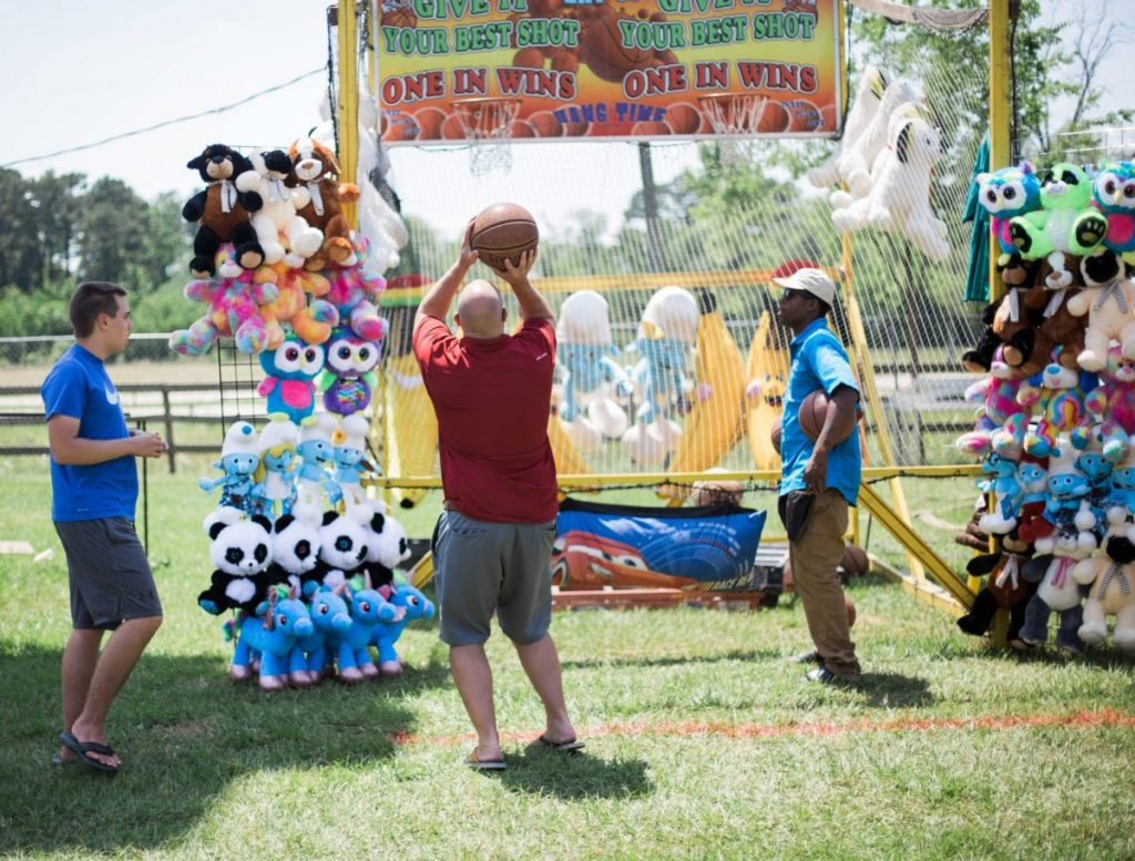 playing carnival basketball at texas crwfish and music festival in old town spring 2018 houston lifestyle blogger mom blog