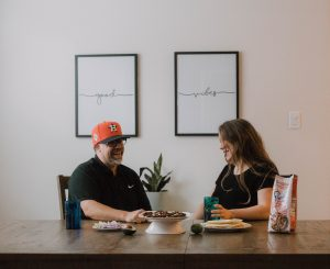 Husband and wife laughing at the table while having dinner together fun conversation starters for couples marriage mommy blogger mom blog lifestyle blog influencer 2017 2108