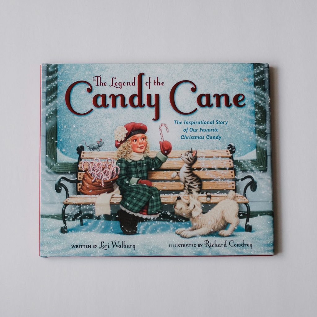 Four favorite Christmas books that we read all year long. Funny touching books for christmas time. Reading books mom blogger lifestyle blog mommy blog 2017 2018 the legend of the candy cane