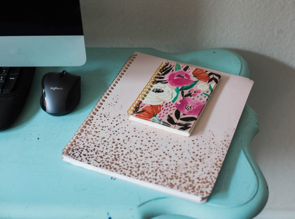 Back to homeschool: a simplified space. A daily planner and notebook are musts.