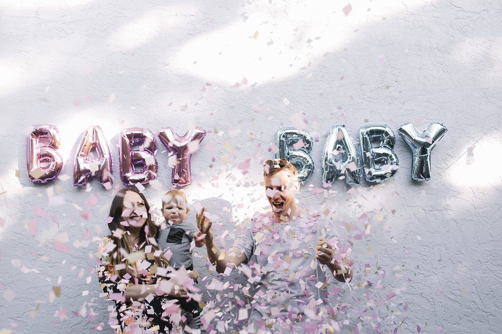Creative gender reveal with pink confetti it's a girl
