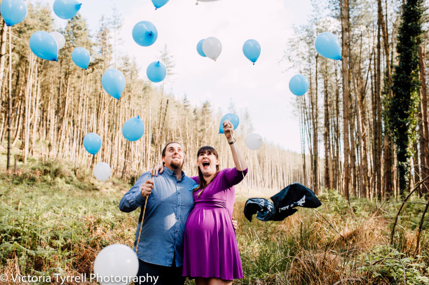 Creative gender reveal it's a boy blue balloons