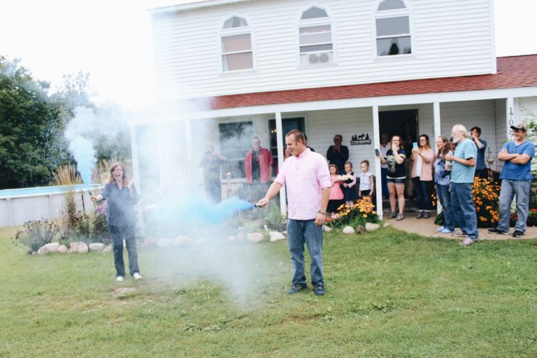 creative gender reveal blue smoke bombs it's a boy